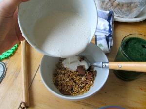 tahini milk over dark chocolate granola